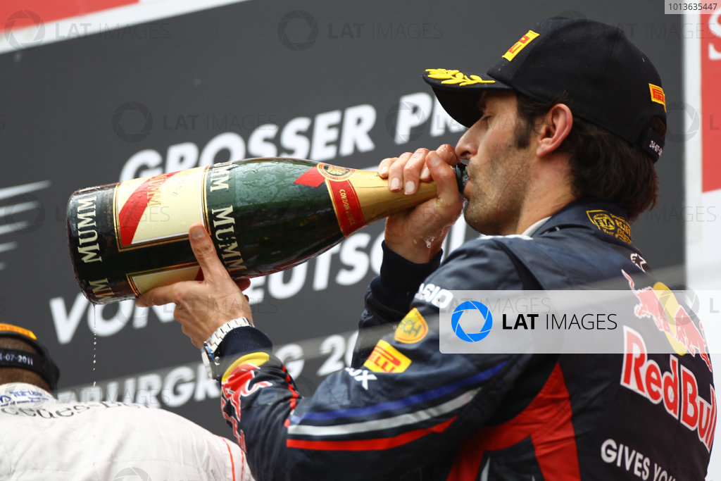 Nurburgring, Germany.24th July 2011Mark Webber, Red Bull Racing RB7 Renault, 3rd position, downs the Champagne. Portrait. Podium. World Copyright: Andy Hone/LAT Photographicref: Digital Image CSP13520