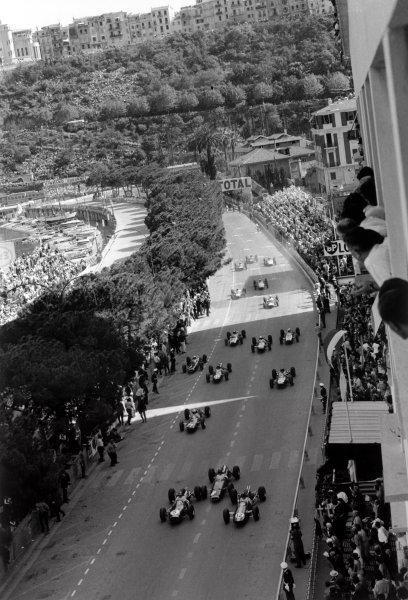 1964 Monaco Grand Prix.Monte Carlo, Monaco. 7-10 May 1964.Jack Brabham (#5 Brabham BT7-Climax) and Jim Clark (#12 Lotus 25-Climax) lead Graham Hill (#8 BRM P261), John Surtees (#21 Ferrari 158), Peter Arundell (#11 Lotus 25-Climax) and Dan Gurney (#6 Brabham BT7-Climax) at the start.World Copyright: LAT PhotographicRef: Autosport b&w print