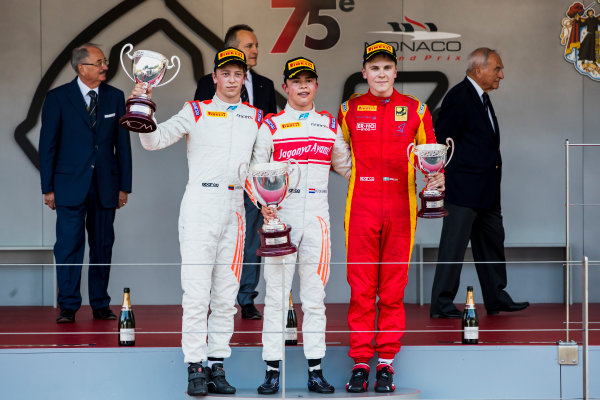 2017 FIA Formula 2 Round 3. Monte Carlo, Monaco. Saturday 27 May 2017. Johnny Cecotto Jr. (VEN, Rapax), Nyck De Vries (NED, Rapax) and Gustav Malja (SWE, Racing Engineering) on the podium. Photo: Zak Mauger/FIA Formula 2. ref: Digital Image _56I7711
