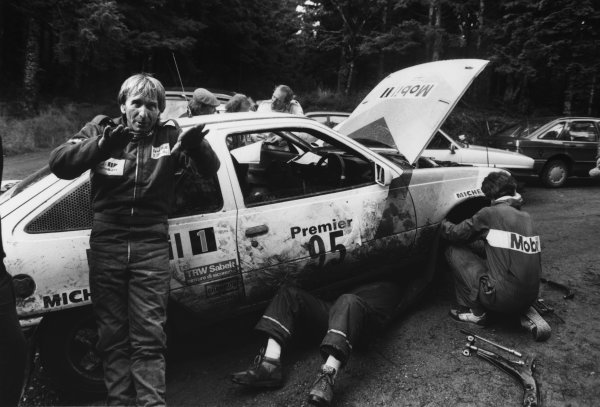 Chester, England. 22nd - 25th November 1987.Derek Bell/Mike Nicholson (Opel Kadett GSI), retired, in a service area, portrait. World Copyright: LAT Photographic.Ref:  B/W Print.