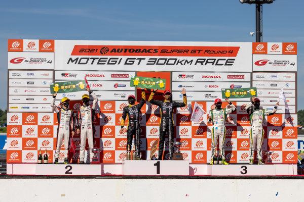 GT300 Winners Hiroki Katoh & Ryohei Sakaguchi, Advics muta Racing INGING & Cars Tokai Dreams28, Lotus Evora MC GT300, celebrate on the podium. Alongside are Katsuyuki Hiranaka & Hironobu Yasuda, GAINER, Nissan GT-R Nismo GT3, 2nd, and Hiroki Yoshida & Kohta Kawaai, Saitama Toyopet GreenBrave GR Supra GT, 3rd