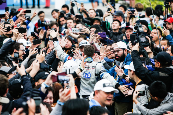 Edoardo Mortara (CHE) Venturi Formula E makes his way through the crowd towards the podium
