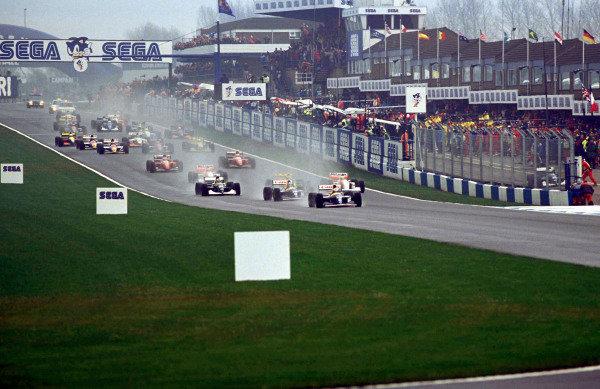 Alain Prost, Williams FW15C Renault, leads Damon Hill, Williams FW15C Renault, Karl Wendlinger, Sauber C12, and Ayrton Senna, McLaren MP4-8 Ford, at the start.