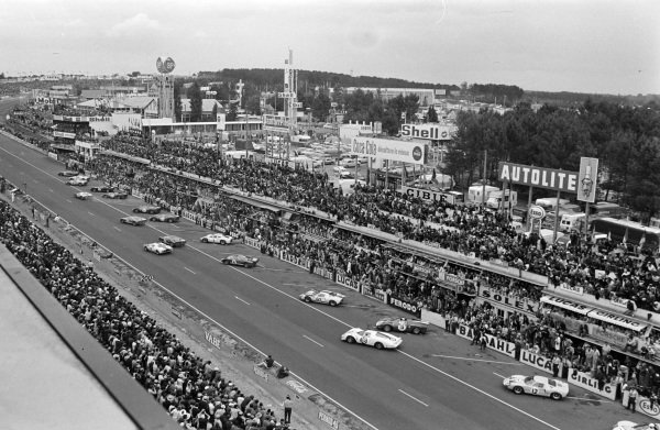 The cars pull away at the start of the race.