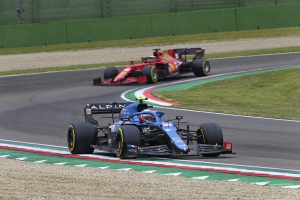 Esteban Ocon, Alpine A521, leads Charles Leclerc, Ferrari SF21
