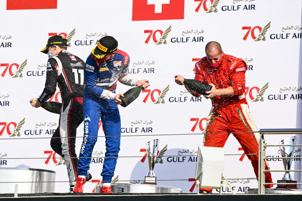 Louis Deletraz (CHE, CHAROUZ RACING SYSTEM), Race winner Robert Shwartzman (RUS, PREMA RACING) and Winning Constructor Representative celebrate on the podium with the champagne