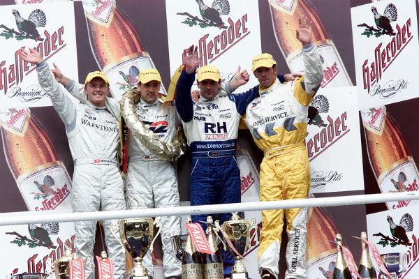 DTM Championship Hockenheim 28th May 2000, Hockenheim, GermanyFrom the left. Marcel Fassler (Mercedes-Benz), Bernd Schneider (Mercedes-Benz), Michael Bartels (Opel), Manuel Reuter (Opel). Podium.