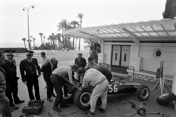 The Bob Bondurant Tyrrell Cooper T76 BMC, is worked on under the observation of police and officials.