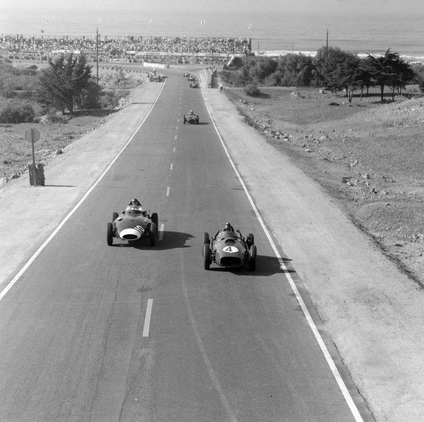 Phil Hill, Ferrari 246, battles with Tony Brooks, Vanwall.
