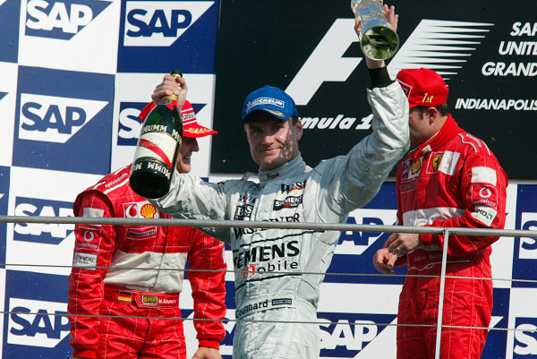 2002 American Grand Prix.Indianapolis, Indiana, USA. 27-29 September 2002.David Coulthard (McLaren Mercedes) celebrates his 3rd position on the podium.World Copyright - LAT Photographicref: Digital File Only