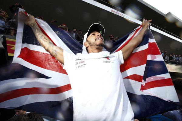 Lewis Hamilton, Mercedes AMG F1, celebrates victory in the drivers championship for a 5th time with his team