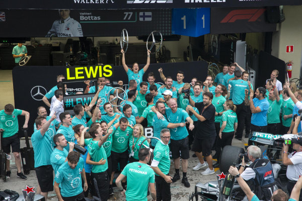 Mercedes-AMG F1 celebrate clinching the Constructors Championship with the champagne