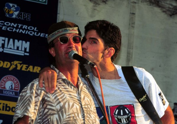 1995 British Grand Prix.Silverstone, England.14-16 July 1995.Eddie Jordan and Damon Hill on stage during the post-Grand Prix party.World Copyright - LAT Photographic