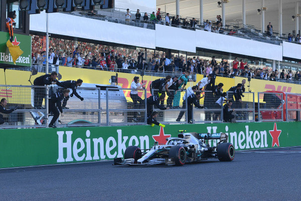 Valtteri Bottas, Mercedes AMG W10, 1st position, passes his team on the pit wall after securing victory
