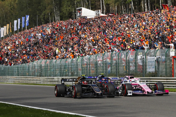 Sergio Perez, Racing Point RP19, leads Kevin Magnussen, Haas VF-19 and Pierre Gasly, Toro Rosso STR14