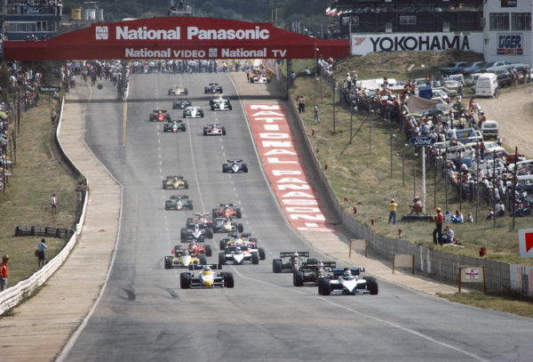 Nelson Piquet, Brabham BT53 BMW, leads the field on the formation lap ahead of the first start. Alain Prost's abandoned McLaren MP4-2 TAG can be seen pushed to the side of the track in the background. Prost would have the opportunity to make a pit lane start after Nigel Mansell, Lotus 95T Renault stalled on the first attempt to run the race.
