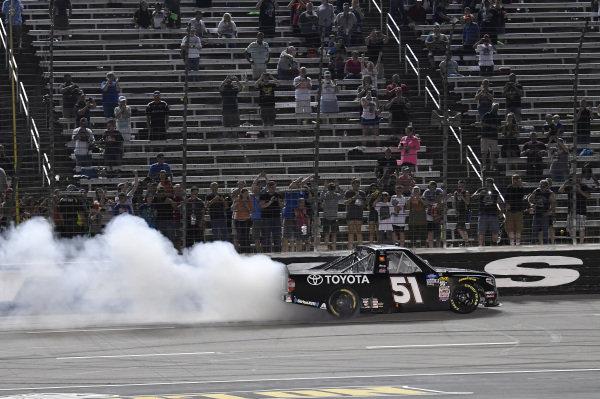 #51: Greg Biffle, Kyle Busch Motorsports, Toyota Tundra Toyota, does a burnout after winning