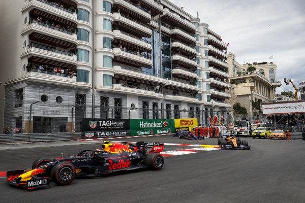Pierre Gasly, Red Bull Racing RB15, leads Carlos Sainz Jr., McLaren MCL34, and Daniil Kvyat, Toro Rosso STR14
