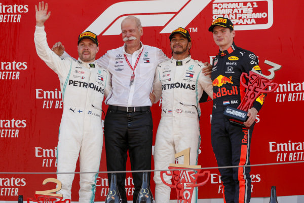 Valtteri Bottas, Mercedes AMG F1, Dr Dieter Zetsche, CEO, Mercedes Benz, Race Winner Lewis Hamilton, Mercedes AMG F1, Max Verstappen, Red Bull Racing celebrate on the podium with the trophy