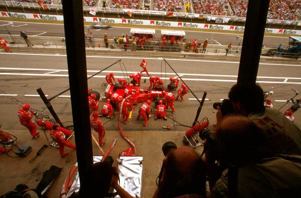 Barcelona, Spain.23-25 May 1997.Michael Schumacher (Ferrari F310B) 4th position, takes a pitstop.Ref-97 ESP 05.World  Copyright - LAT Photographic