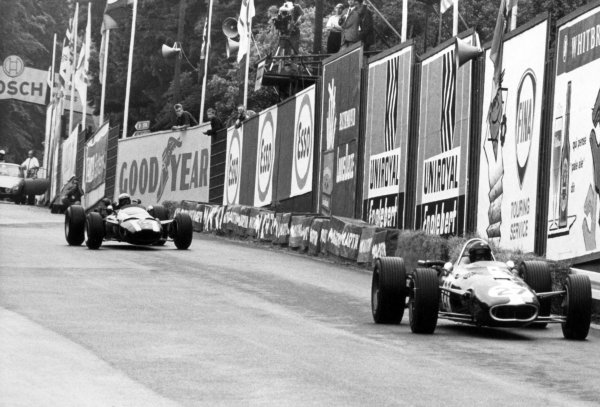 1966 Belgian Grand Prix.Spa-Francorchamps, Belgium. 12 June 1966.Dan Gurney, Eagle AAR101-Climax, not classified, leads Richie Ginther, Cooper T81-Maserati, 5th position, action.World Copyright: LAT PhotographicRef: Autosport b&w print