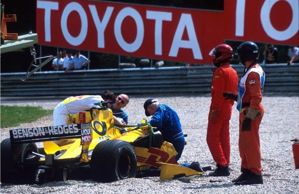Professor Sid Watkins (GBR), right of cockpit tends to Takuma Sato (JPN) who has just made high-speed contact with the Sauber of Heidfeld. Austrian Grand Prix, A1-Ring, Austria, 12 May 2002 BEST IMAGE