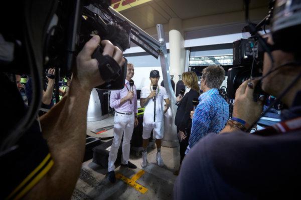 Bahrain International Circuit, Sakhir, Bahrain. Sunday 19 April 2015. Lewis Hamilton, Mercedes AMG, 1st Position, is interviewed by Suzi Perry and Eddie Jordan, BBC Sport F1. World Copyright: Steve Etherington/LAT Photographic. ref: Digital Image SNE24574
