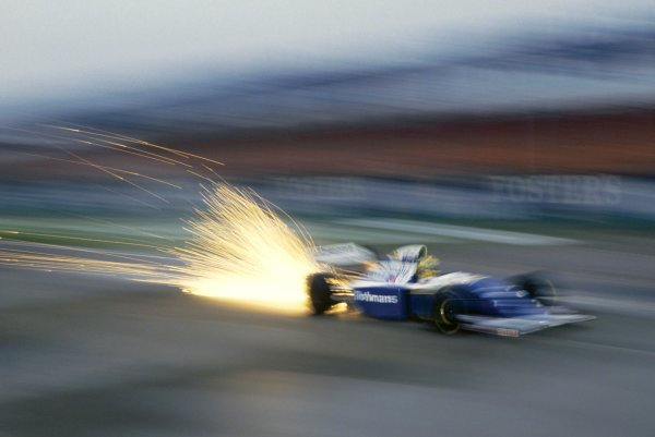 The Williams FW16 of Ayrton Senna (BRA) sends out a shower of sparks whilst testing before the opening race of the season. Formula One Testing, Silverstone, England, 24 February 1994.
