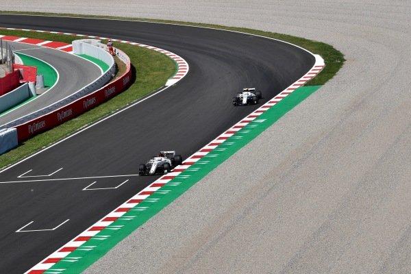 Marcus Ericsson (SWE) Alfa Romeo Sauber C37 and Charles Leclerc (MON) Alfa Romeo Sauber C37