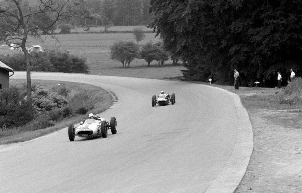 Tenth place finisher Masten Gregory (USA) Cooper T53 leads eighth place finisher Stirling Moss (GBR) Lotus 18/21.