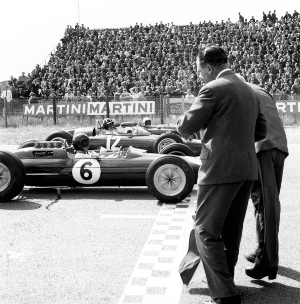 1963 Dutch Grand Prix. Zandvoort, Holland. 21-23 June 1963. (L-R) Jim Clark (Lotus 25 Climax) 3rd on the grid, with Graham Hill (BRM P261) 2nd and Dan Gurney (Brabham BT7 Climax) on pole position behind, at the start. Ref-20021B/W. World Copyright - LAT Photographic