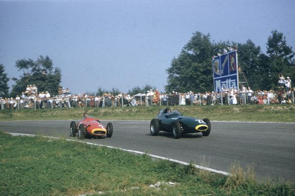 Monza, Italy. 6-8 September 1957. Tony brooks, Vanwall, leads Juan Manuel Fangio, Maserati 250F. Ref: 57ITA37. World Copyright - LAT Photographic