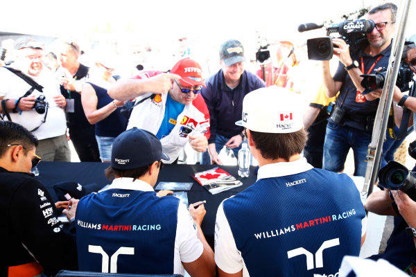 Circuit Gilles Villeneuve, Montreal, Canada. Thursday 08 June 2017. Lance Stroll, Williams Martini Racing, and Felipe Massa, Williams Martini Racing, sign autographs for fans. World Copyright: Andy Hone/LAT Images ref: Digital Image _ONZ9786