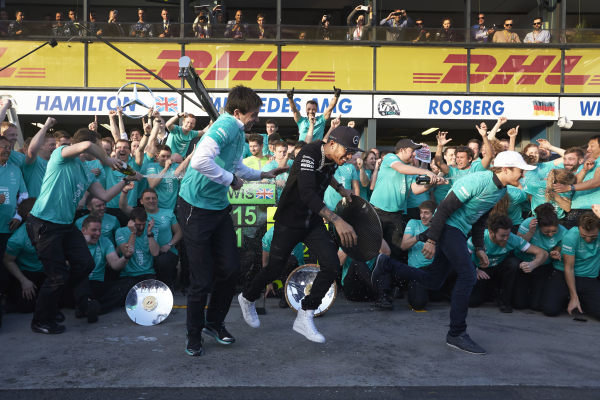 Albert Park, Melbourne, Australia. Sunday 15 March 2015. Lewis Hamilton, Mercedes AMG and Nico Rosberg, Mercedes AMG celebrate with their team after winning the race. World Copyright: Steve Etherington/LAT Photographic. ref: Digital Image SNE11620