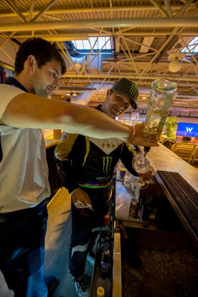 Autosport International Exhibition.  National Exhibition Centre, Birmingham, UK. Sunday 17 January 2016.  Petter Solberg learns how to mix Martini cocktails on the Williams motorhome. World Copyright: Zak Mauger/LAT Photographic. ref: Digital Image _L0U9412