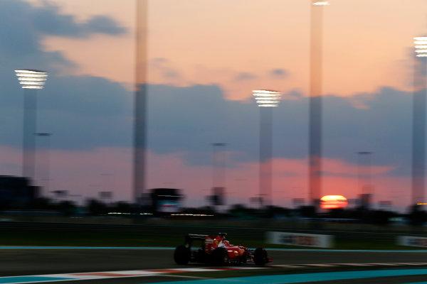 Yas Marina Circuit, Abu Dhabi, United Arab Emirates. Friday 27 November 2015. Kimi Raikkonen, Ferrari SF-15T. World Copyright: Charles Coates/LAT Photographic ref: Digital Image _99O7288