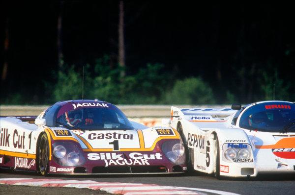 Le Mans, France. 11th - 12th June 1988 Martin Brundle/John Nielsen, Jaguar XJR-9 LM, retired, collides with Jesus Pareja/Massimo Sigala.Uwe Schafer, Porsche 962C, 7th position, action. World Copyright: LAT Photographic ref: 88LM41