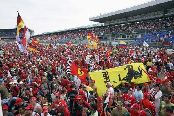 2006 German Grand Prix - Sunday Race Hockenheim, Germany. 27th - 30th July. Ferrari fans swarm around the podium. Atmosphere. World Copyright: Lorenzo Bellanca/LAT Photographic ref: Digital Image ZD2J2165