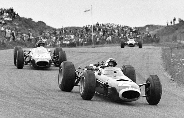 1965 Dutch Grand Prix.Zandvoort, Holland. 18 July 1965.Jackie Stewart, BRM P261, 2nd position, leads Dan Gurney, Brabham BT11-Climax, 3rd position, action.World Copyright: LAT Photographic.ref: Motor b/w print.