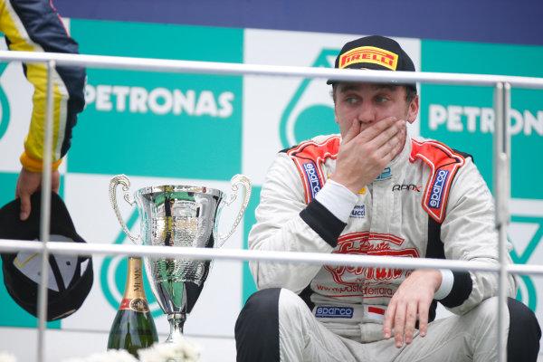 2013 GP2 Series. Round 1.  Sepang, Kuala Lumpur, Malaysia. 24th March 2013.  Sunday Race.  Stefano Coletti (MON, Rapax) celebrates his victory on the podium.  World Copyright: Alastair Staley/GP2 Series Media Service.  ref: _89P0693