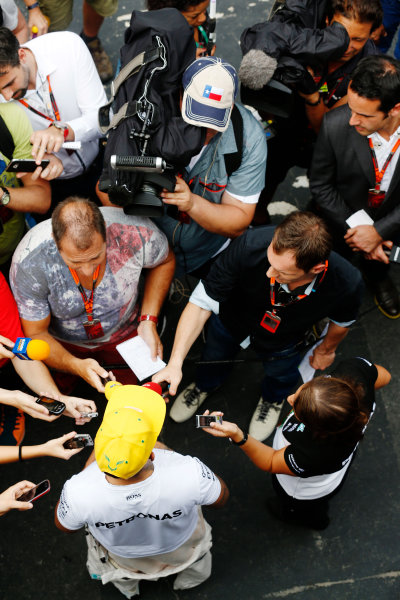 Interlagos, Sao Paulo, Brazil. Friday 13 November 2015. Lewis Hamilton, Mercedes AMG, is interviewed. World Copyright: Alastair Staley/LAT Photographic ref: Digital Image _R6T3763