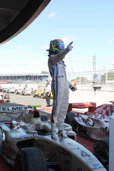 Silverstone, England. 11th July.Sunday Race. Sergio Perez (MEX, Barwa Addax Team) celebrates his victory. Photo: Jakob Ebrey/GP2 Media Service.Ref: _MKO_9270 jpg