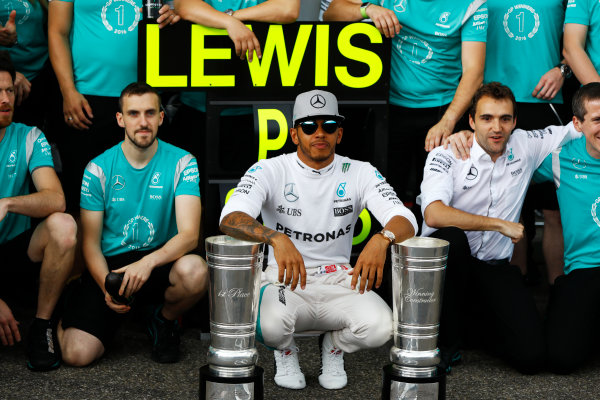 Hockenheim, Germany. Sunday 31 July 2016. Lewis Hamilton, Mercedes AMG, 1st Position, with the days trophy haul, celebrates with his team. World Copyright: Andrew Hone/LAT Photographic ref: Digital Image _ONY1491
