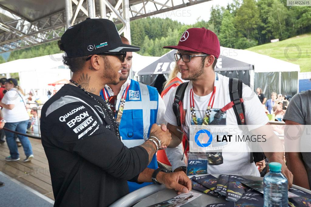 Red Bull Ring, Spielberg, Austria. Saturday 2 July 2016. Lewis Hamilton, Mercedes AMG, meets a fan. World Copyright: Steve Etherington/LAT Photographic ref: Digital Image SNE26863