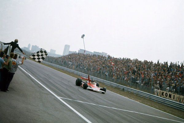 Zandvoort, Holland. 27th - 29th August 1976. James Hunt (McLaren M23 Ford), 1st position, takes the chequered flag, action.  World Copyright: LAT Photographic.  Ref:  76 HOL 11.