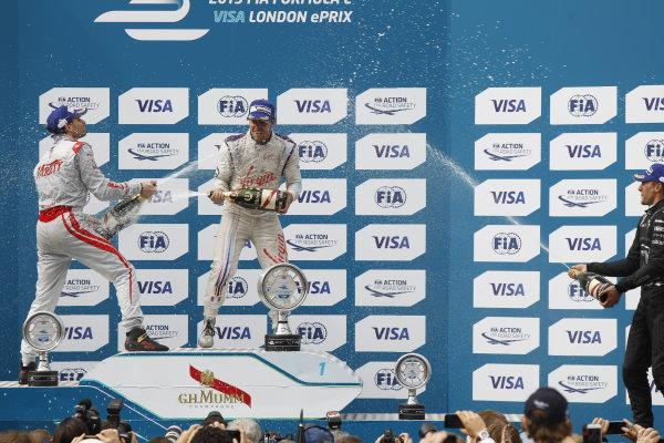 2014/2015 FIA Formula E Championship. London e-Prix, Battersea Park, London, UK. Sunday 28 June 2015. Sam Bird (GBR)/Virgin Racing - Spark-Renault SRT_01E Jerome D'Ambrosio (BEL)/Dragon Racing - Spark-Renault SRT_01E and Loic Duval (FRA)/Dragon Racing - Spark-Renault SRT_01E celebrate on the podium. World Copyright: Sam Bloxham/LAT Photographic/Formula E. ref: Digital Image _G7C8677