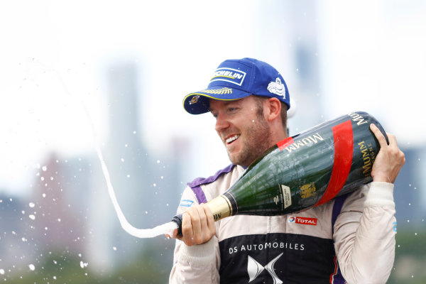 2016/2017 FIA Formula E Championship. Round 9 - New York City ePrix, Brooklyn, New York, USA. Saturday 15 July 2017. Sam Bird (GBR), DS Virgin Racing, Spark-Citroen, Virgin DSV-02, sprays the champagne on the podium. Photo: Alastair Staley/LAT/Formula E ref: Digital Image _R3I0056
