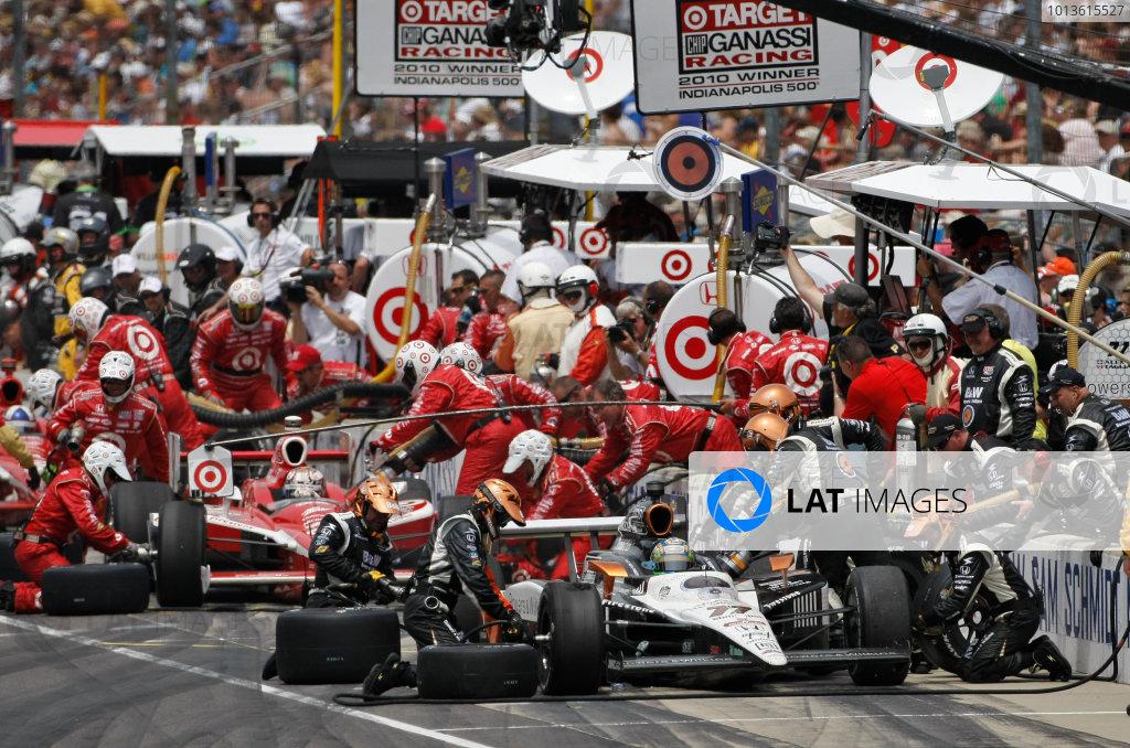 29 May, 2011, Indianapolis, Indiana, USAAlex Tagliani and Scott Dixon make pit stops.© 2011 Phillip AbbottLAT Photo USA