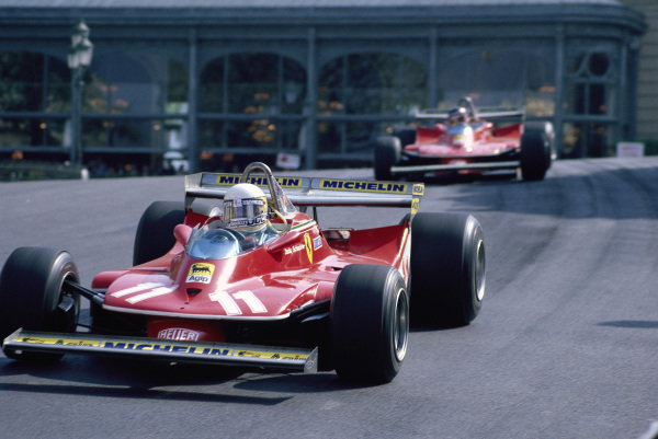 Jody Scheckter, Ferrari 312T4, leads his teammate Gilles Villeneuve through Casino Square.
