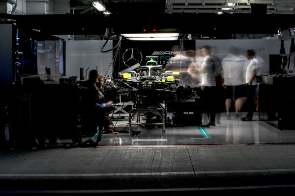 Engineers work on the car of Lewis Hamilton, Mercedes AMG F1 W09 EQ Power+, in the garage